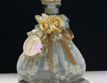 Creazioni Artistiche: bottiglia grande vetro pizzo fiori fatta in Italia