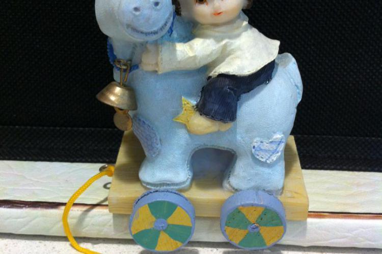 offerta speciale bomboniere per comunione e Battesimo bimbo su cavallo