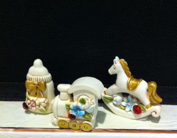 bomboniere battesimo: biberon, treno, cavallo Cupido offerta speciale